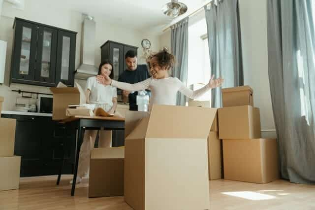 Family preparing for moving after being able to buy and sell a house at the same time
